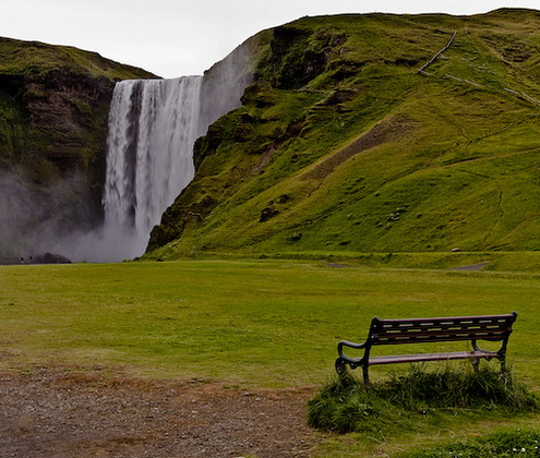 Iceland waterfall and a bench